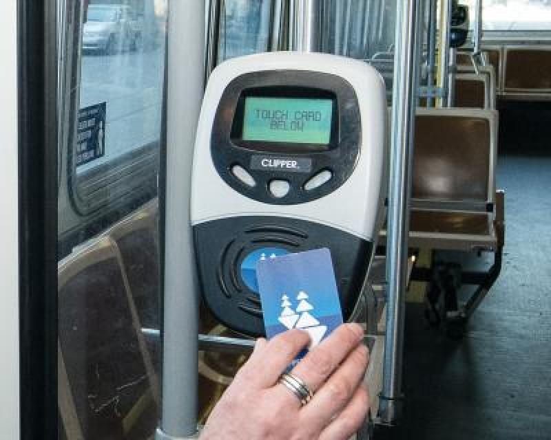 Person paying with clipper card