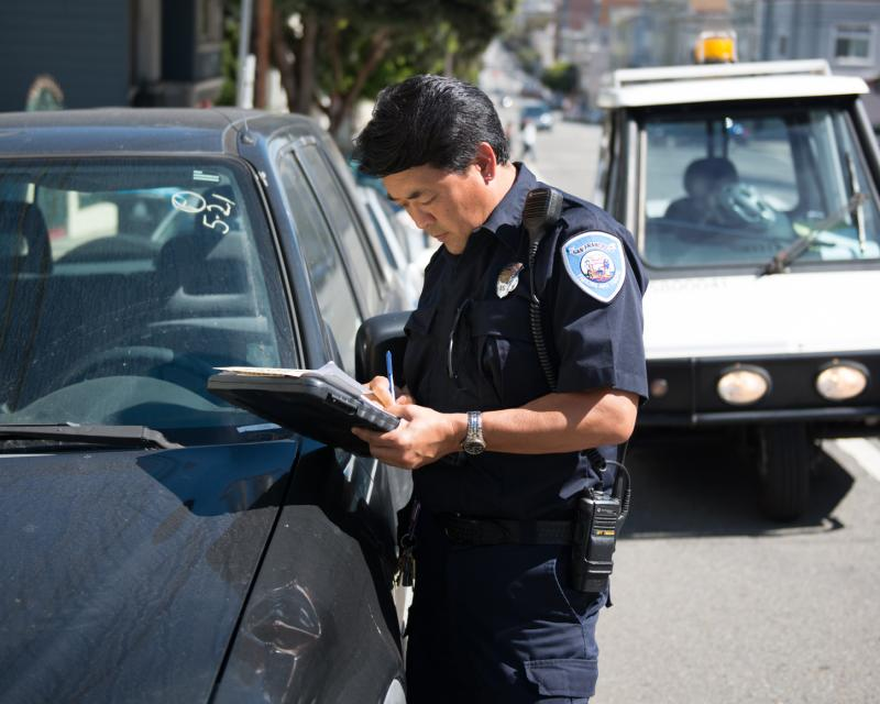 PCO issuing parking ticket