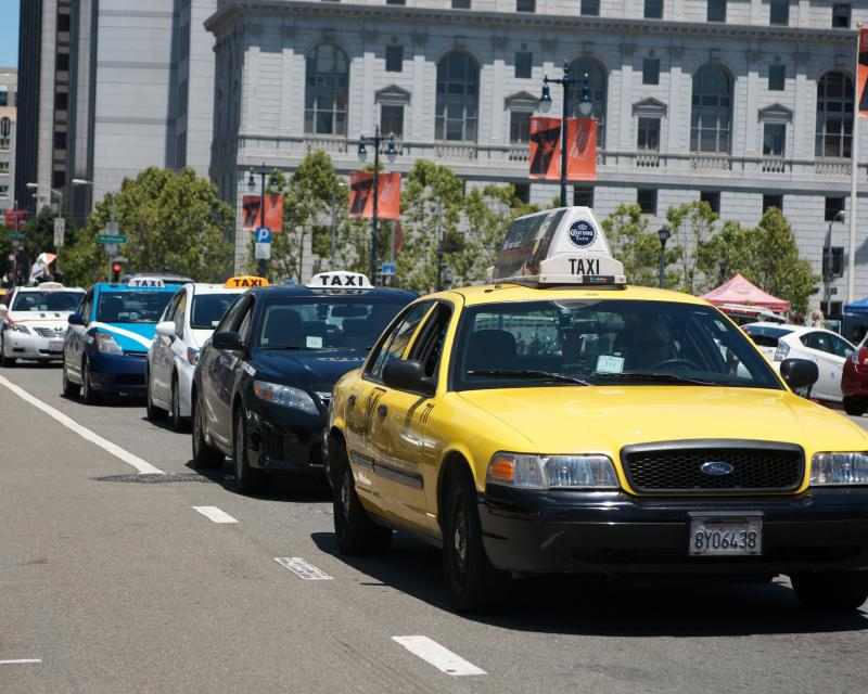 Line of taxis outside of city hall