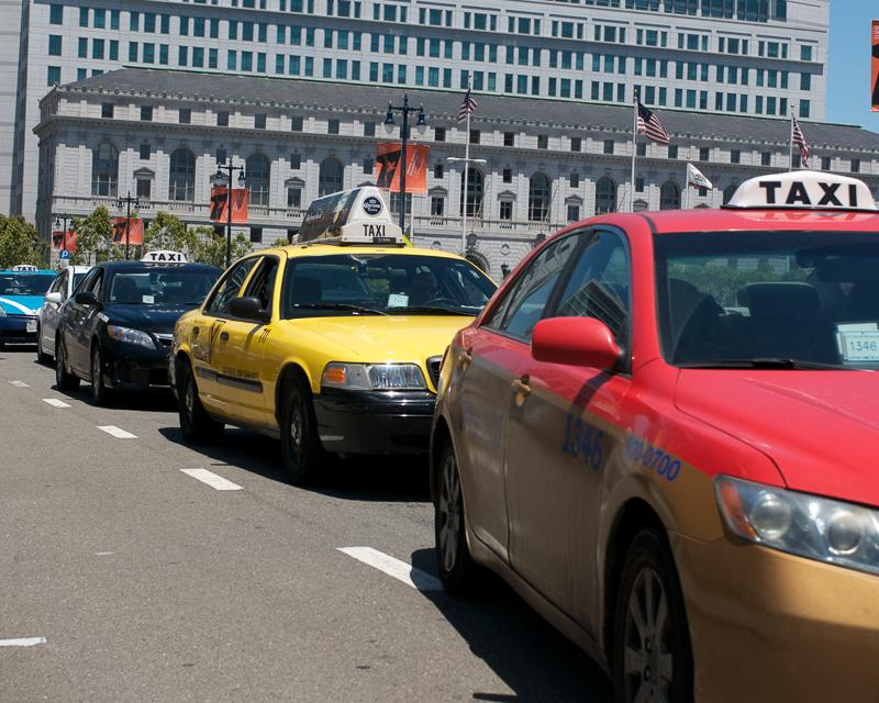 line of taxicabs outside city hall in civic center plaza