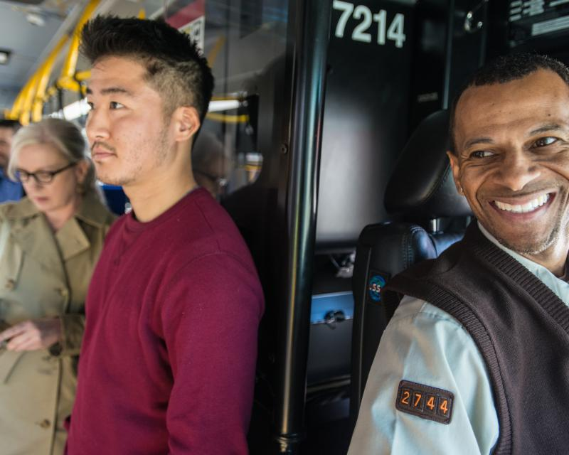 Photo of Muni operator and passengers in background