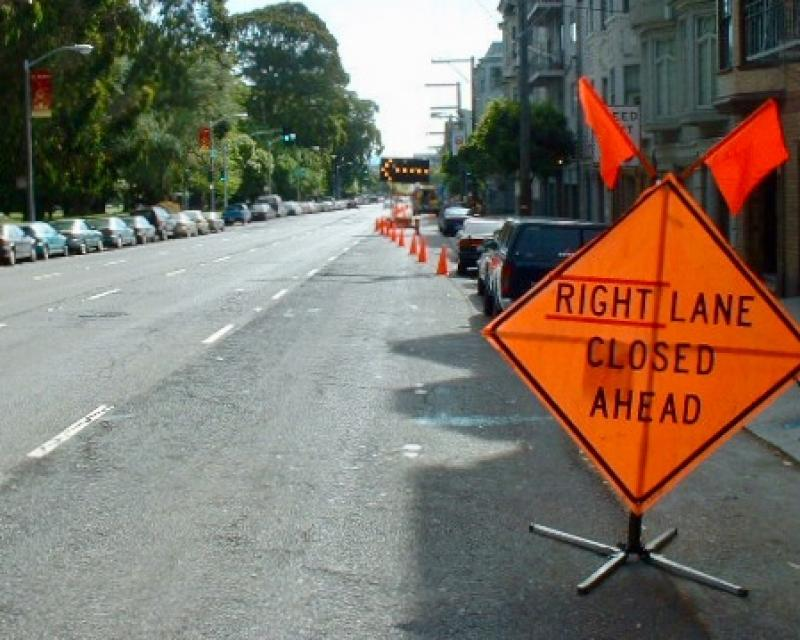 construction work with right lane closed ahead signage