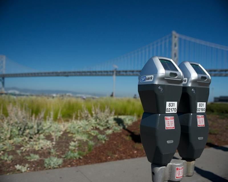 Picture of two parking meters on The Embarcadero with the Bay Bridge in the background
