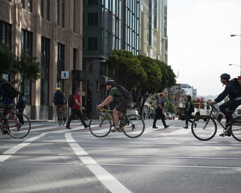 Bicyclists crossing 10th St
