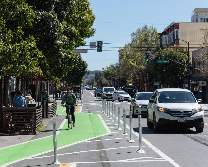Person biking on the new street design on Valencia Street