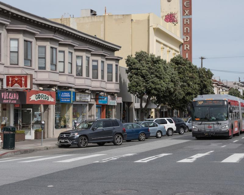 bus traveling down Geary Boulevard