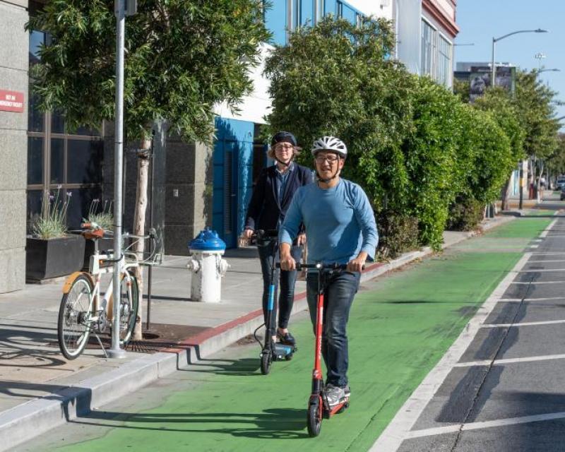 Scooter riders on bike lane
