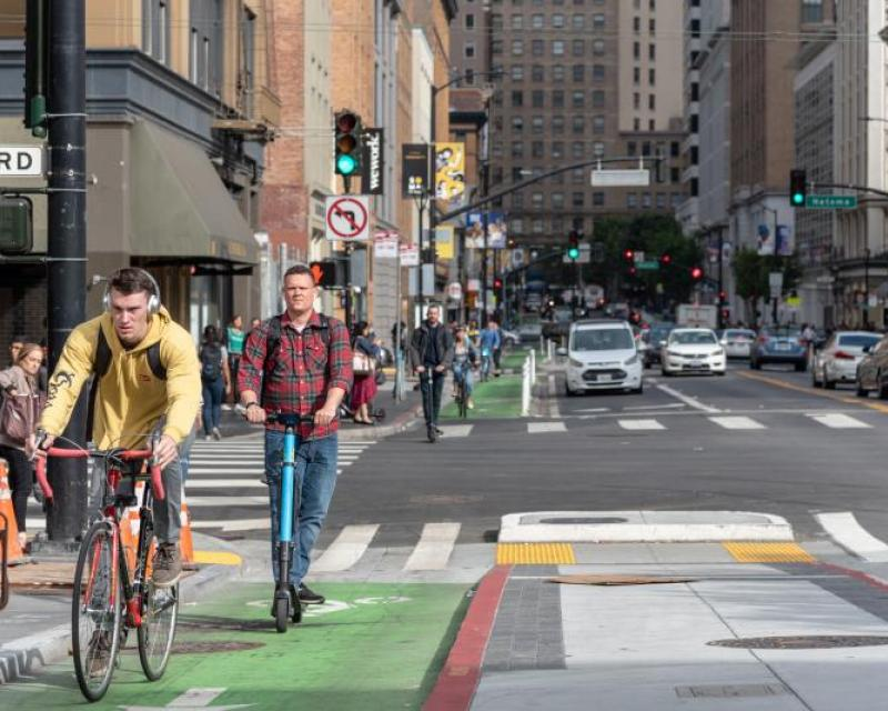 Image of bike and scooter riding in San Francisco downtown