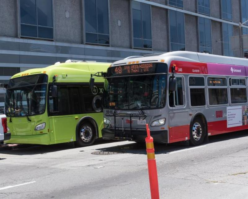 Electric bus and hybred bus in frount of One South Van Ness