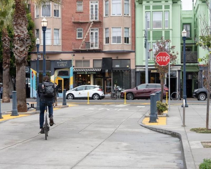person biking on octavia street