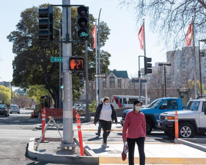 Image shows pedestrians walking across Geary Boulevard