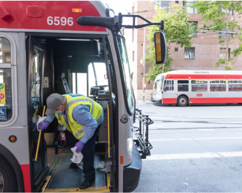 Picture of Muni Car Cleaner wiping down bus railings