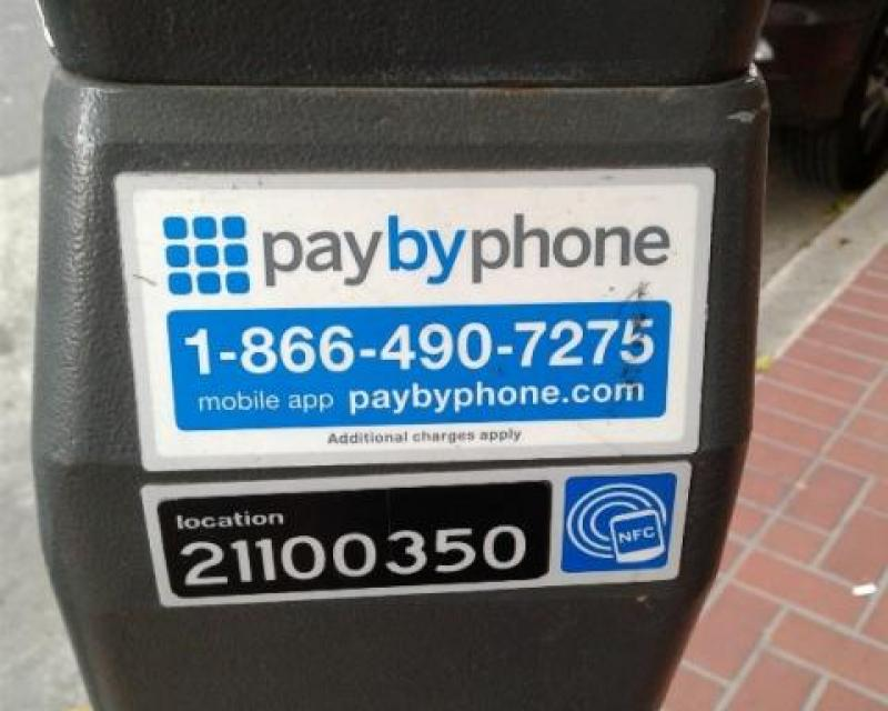 Pay by phone decal showing phone number, meter number, and URL