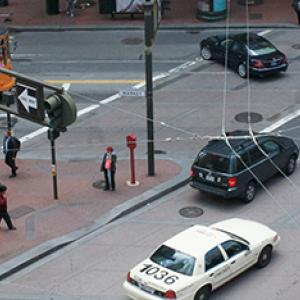 Market Street with streetcar, autos and pedestrians