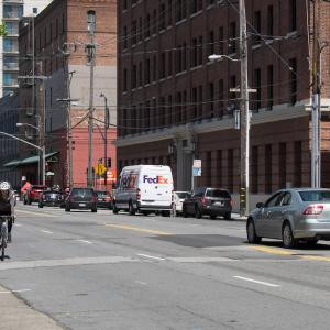 Woman riding bike on Brannan Street near Second Street