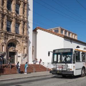 Muni arriving outside of a San Francisco school