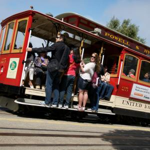 Cable car riders travel uphill