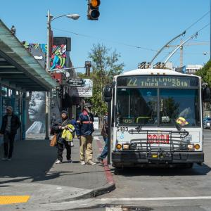 22 Fillmore bus picking up passengers on fillmore and geary