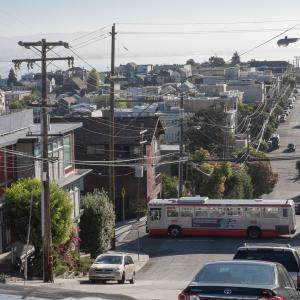 19 Polk bus driving through Potrero Hill with neighborhood and bay views in background