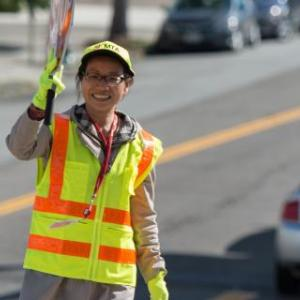Crossing guard stands at an intersection