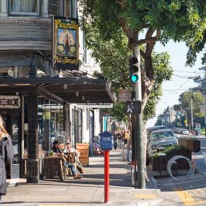 A pedestrian on Haight Street at Masonic Avenue