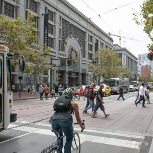 Pedestrians, cyclist, and Muni on Market Street near 5th