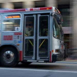 A Muni bus driving.
