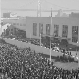 crowd with old transbay terminal and bay bridge
