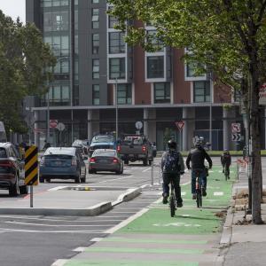 People biking on 8th Street towards Townsend