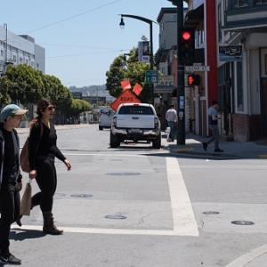 People crossing the street in Dogpatch.