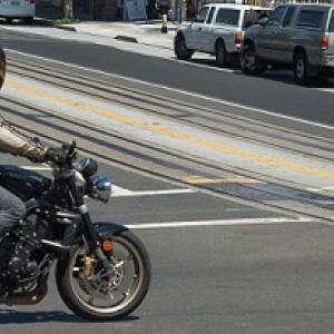 Motorcycle crossing an intersection.