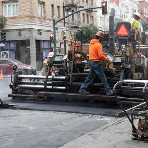 Men working on Polk Street.