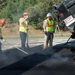 SFMTA crews working on speed humps.