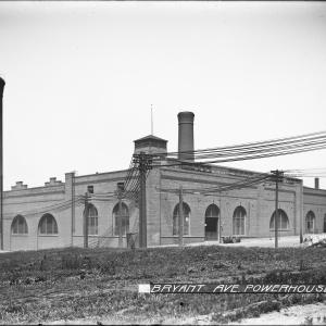 brick building with smokestacks and arched windows
