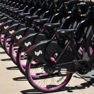 new lyft e-bikes docked at staions