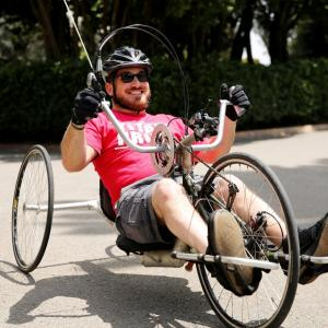man riding a recumbent trike