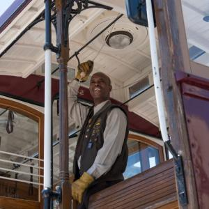 a cable car conductor competes in the bell ringing contest from 2017