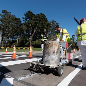 Paint shop striping a crosswalk in Golden Gate Park