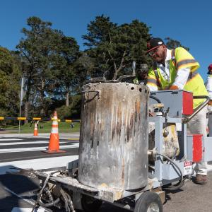 Crosswalks being painted inside Golden Gate Park