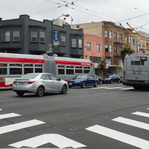 Two coaches with in the Mission District