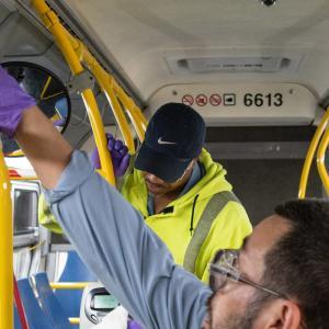 SFMTA Car Clean crew at work preparing a bus for a new day