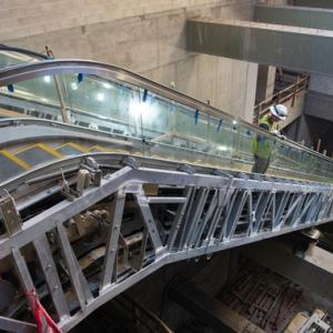 Working on escalator in Rose Pak Chinatown Station