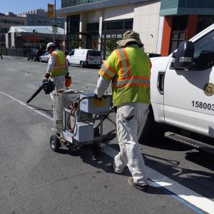 Work crews paint 4th Street Transit Lane