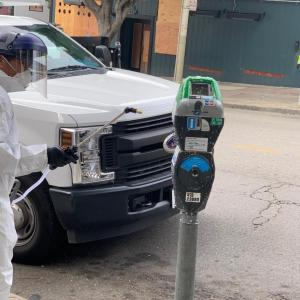 Parking Meter Being Cleaned