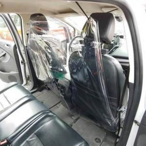 inside of a taxi showing the bubble shield between driver and passenger
