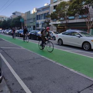 Bikers using the bike lanes on Folsom Street