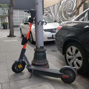 A Spin scooter parked with a lock-to device