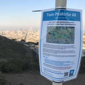 Twin Peaks flyer on top of Twin Peaks overlooking San Francisco