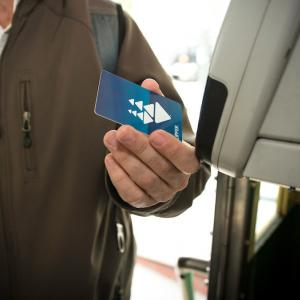 A customer pays their fare with a clipper card