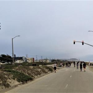 Car-free Great Highway at Noriega Street looking south with pedestrians and bicyclists next to Ocean Beach